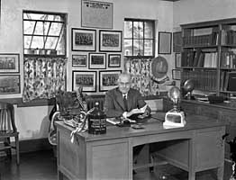 fielding yost at desk in new office in athletic building date