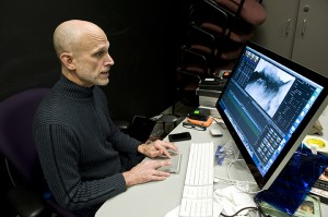 Sparling edits video in the Pop-Up Projectile Pavilion in U-M's North Campus Research Complex.