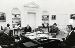 Governor Milliken (far right) meets with President Ford (far left) in the Oval Office in 1976. HS19510